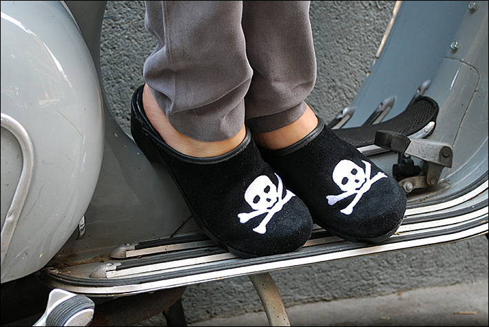Sometimes all you need is a little mascara and a pair of heels to make any cloudy day, sunny — except I'm really into comfort. So I love my Nike wedge sneakers, Converse platforms, and clogs (especially my skull & crossbones pair).
