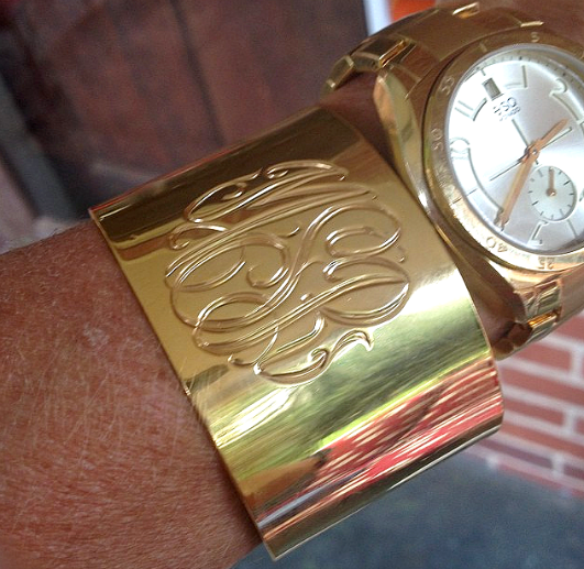 Beautiful Summer Jewelry Trends - wide monogrammed bangle and watch stack